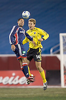 Clint Dempsey (NE Revolution, blue) and Chad Marshall (Columbus Crew, yellow) battle for a head ball. NE Revolution defeat Columbus Crew, 1-0, at Gillette Stadium and secure home field advantage in the Eastern Conference Semifinal Series on October 14, 2006.