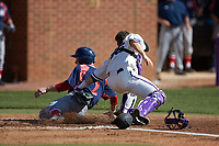 Jesse Uttendorfer (2) of the NJIT Highlanders steals home plate ahead of the tag by High Point Panthers catcher Spencer Brown (26) at Williard Stadium on February 19, 2017 in High Point, North Carolina. The Panthers defeated the Highlanders 6-5. (Brian Westerholt/Four Seam Images)