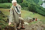 Portrait of the writer and artist Alfred Wainwright in the Lake District, Cumbria, England. Circa 1970. Path leading up from Grasmere.