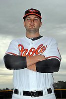 Feb 27, 2010; Tampa, FL, USA; Baltimore Orioles  infielder Scott Moore (6) during  photoday at Ed Smith Stadium. Mandatory Credit: Tomasso De Rosa/ Four Seam Images