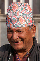 Nepal, Patan.  Nepalese Man Wearing Traditional Hat, a Dhaka Topi, a Tika on his Forehead.