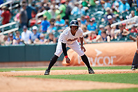 Birmingham Barons left fielder Eloy Jimenez (21) leads off first base during a game against the Pensacola Blue Wahoos on May 9, 2018 at Regions FIeld in Birmingham, Alabama.  Birmingham defeated Pensacola 16-3.  (Mike Janes/Four Seam Images)
