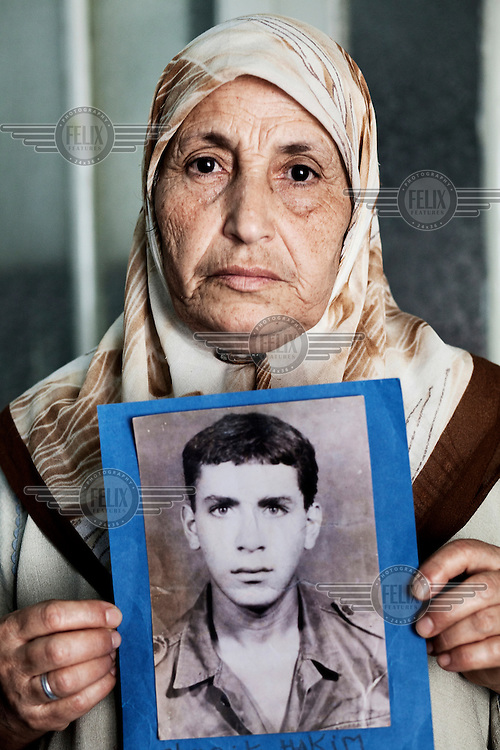 Djedligua Chenguit holds a picture of her missing son Hakim, who disappeared in 1993. Thousands of individuals disappeared during the civil war in the 1990's but no proper investigations have been carried out by the Algerian authorities.