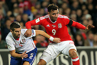 Hal Robson-Kanu of Wales (R) is challenged by Matija Nastasic of Serbia during the 2018 FIFA World Cup Qualifier between Wales and Serbia at the Cardiff City Stadium, Wales, UK. Saturday 12 November 2016