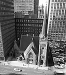 Pittsburgh PA: View of the First English Evangelical Church in downtown Pittsburgh.  Founded in 1837, the church was the first English-speaking Lutheran Church west of the Allegheny Mountains. This building on Grant Street was dedicated in 1888.  The Alcoa building is on the left.