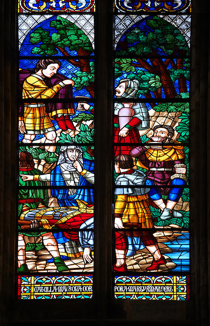 Medieval Gothic stained glass window showing  scenes from the Martyrdom of Saint Denis. The Gothic Cathedral Basilica of Saint Denis ( Basilique Saint-Denis ) Paris, France. A UNESCO World Heritage Site.. The Gothic Cathedral Basilica of Saint Denis ( Basilique Saint-Denis ) Paris, France. A UNESCO World Heritage Site.