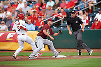 Frisco RoughRiders first baseman Trever Adams (29) stretches for a throw as Charlie Tilson (8) gets back to the bag with umpire Jake Wilburn looking on during a game against the Springfield Cardinals on June 3, 2015 at Hammons Field in Springfield, Missouri.  Springfield defeated Frisco 7-2.  (Mike Janes/Four Seam Images)