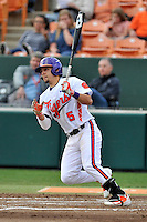 Center fielder Chase Pinder (5) of the Clemson University Tigers bats in a game against the Wofford College Terriers on Tuesday, March 1, 2016, at Doug Kingsmore Stadium in Clemson, South Carolina. Clemson won, 7-0. (Tom Priddy/Four Seam Images)