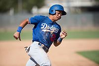 Los Angeles Dodgers infielder Marcus Chiu (22) rounds third base during an Instructional League game against the Milwaukee Brewers at Maryvale Baseball Park on September 24, 2018 in Phoenix, Arizona. (Zachary Lucy/Four Seam Images)