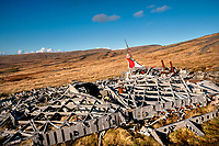 "Pictured: The wreckage of the Wellington Bomber MF509 in the Brecon Beacons, Wales, UK. <br /> Re: The nephew of a World War II airman whose plane crashed into a Welsh mountain has climbed the peak to pay tribute to the uncle he never met.<br /> Dr Peter Paré, 74, travelled from his home in Vancouver, Canada, to read a poem at the desolate spot where his uncle Bill Allison was killed.<br /> Flying officer Allison, 28, was one of the six crew of a Wellington Bomber that crashed on a training flight in November 1944.<br /> The plane wreckage is still scattered over Carreg Goch in the Brecon Beacons where hundreds of young airmen learned to prepare for bombing missions.<br /> Dr Paré said: ""I wanted to make this pilgrimage even though I was a baby when he died and never met Bill Allison.<br /> ""We only found out about the crash site recently and it is remarkable that so much of the plane is still here.""<br /> Flying officer Allison was the oldest on board when the plane's starboard engine developed a fault during a low-flying exercise.<br /> For years local people have honoured the brave airmen by flying a Canadian flag at the scene - replacing it every time it gets ripped by strong winds.<br /> Dr Paré, retired Professor of Medicine at the University of British Columbia, said: ""It was very moving to see the Maple Leaf flying where my uncle died all those years ago.<br /> ""It brought a tear to my eye as I read the poem I wrote in his honour."""