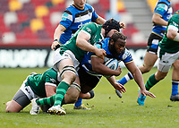 27th March 2021; Brentford Community Stadium, London, England; Gallagher Premiership Rugby, London Irish versus Bath; Ben Obano of Bath is tackled by Matt Rogerson of London Irish