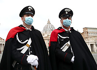 Italian Carabinieri stand in front of St. Peter's basilica at Vatican on December 25, 2020, before the Pope delivers a live-streamed Urbi et Orbi blessing inside the Vatican Blessing hall amid the Covid-19 pandemic.<br /> UPDATE IMAGES PRESS/Isabella Bonotto<br /> <br /> STRICTLY ONLY FOR EDITORIAL USE
