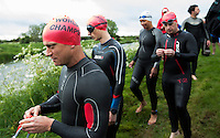 25 MAY 2014 - BRIGG, GBR - Competitors prepare to enter the water for the swim along the River Ancholme during the World Quadrathlon Federation 2014 Middle Distance World Championships at the Brigg Bomber in Brigg in Lincolnshire, Great Britain (PHOTO COPYRIGHT © 2014 NIGEL FARROW, ALL RIGHTS RESERVED)