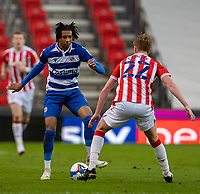 6th February 2021; Bet365 Stadium, Stoke, Staffordshire, England; English Football League Championship Football, Stoke City versus Reading; Michael Olise of Reading under pressure from Sam Clucas of Stoke City