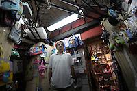 """La cartoleria """"la Luna"""" ha riaperto in aprile 2011, nonostante i puntellamenti all'interno.Il titolare Giuseppe Colaneri..Dopo il terremoto  del 2009 alcuni negozi e attività commerciali riaprono a L'Aquila..After the earthquake of 2009, some shops and businesses reopen in L'Aquila."""