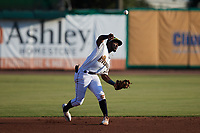 Charleston RiverDogs shortstop Osleivis Basabe (9) makes a throw to first base against the Down East Wood Ducks at Joseph P. Riley, Jr. Park on September 26, 2021 in Charleston, South Carolina. (Brian Westerholt/Four Seam Images)