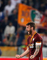 Calcio, Serie A: Roma vs ChievoVerona. Roma, stadio Olimpico, 31 ottobre 2013.<br /> AS Roma midfielder Daniele De Rossi celebrates at the end of the Italian Serie A football match between AS Roma and ChievoVerona at Rome's Olympic stadium, 31 October 2013. AS Roma won 1-0.<br /> UPDATE IMAGES PRESS/Riccardo De Luca