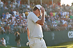 DORAL, FL. - Nick Watney covers his face after missing a putt from the fringe on hole 18 during final round play at the 2009 World Golf Championships CA Championship at Doral Golf Resort and Spa in Doral, FL. on March 15, 2009