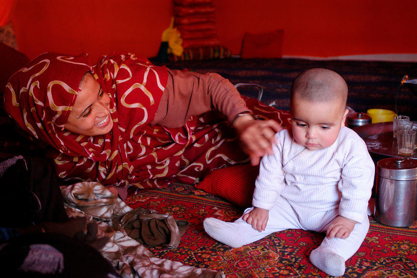 A women plays with her daugther on December 13, 2003, in the Saharawi refugee camps. Saharawi people have been living at the refugee camps of the Algerian desert named Hamada, or desert of the deserts, for more than 30 years now. Saharawi people have suffered the consecuences of European colonialism and the war against occupation by Moroccan forces. Polisario and Moroccan Army are in conflict since 1975 when Hassan II, Moroccan King in 1975, sent more than 250.000 civilians and soldiers to colonize the Western Sahara when Spain left the country. Since 1991 they are in a peace process without any outcome so far. (Ander Gillenea / Bostok Photo)