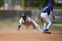 Jasiah Dixon slides into second base as Orlando Salinas (67) covers the bag during the WWBA World Championship at the Roger Dean Complex on October 21, 2018 in Jupiter, Florida.  Jasiah Dixon is an outfielder from Riverside, California who attends Orange Lutheran High School and is committed to Southern California.  (Mike Janes/Four Seam Images)