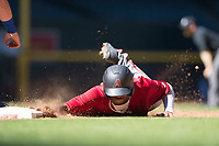 Try Holmes (11) of the Arizona Diamondbacks slides into first base during an Instructional League game against the Kansas City Royals at Chase Field on October 14, 2017 in Phoenix, Arizona. (Zachary Lucy/Four Seam Images)
