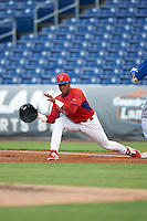 GCL Phillies first baseman Edwin Rodriguez (30) stretches for a throw during a game against the GCL Blue Jays on August 16, 2016 at Bright House Field in Clearwater, Florida.  GCL Blue Jays defeated GCL Phillies 2-1.  (Mike Janes/Four Seam Images)