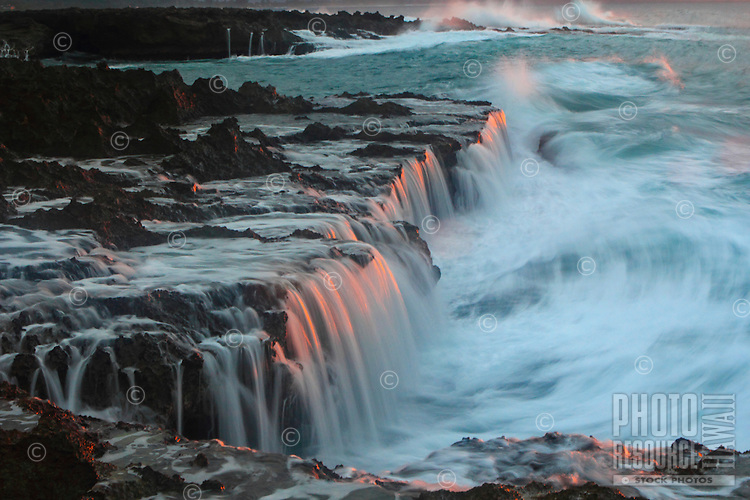 Water cascading off of the rocks at sunset at Shark's Cove on the North Shore of Oahu