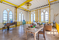 BNPS.co.uk (01202 558833)<br /> Pic: Savills/BNPS<br /> <br /> The property boast high ceilings.<br /> <br /> Water View...Former water tower near Aldeburgh in Suffolk<br /> <br /> A huge six storey former water tower which resembles a castle gate house has emerged on to the market for £1million.<br /> <br /> Grade II listed West Bar, in Thorpeness, provides the perfect vantage point to take in breathtaking views of the Suffolk coast.<br /> <br /> It was designed by architect William Gilmour Wilson in the 1920s in a mock tudor style, with mullioned windows and parapets.<br /> <br /> The six storey, five bedroom property, boasting distinctive full length windows and open fireplaces, has two spacious 'tower' rooms.<br /> <br /> The water tanks were taken out by the deceased owner about 20 years ago. It is being sold with estate agent Savills by his children.