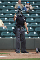 Home plate umpire Matthew Brown makes a strike call during the Carolina League game between the Salem Red Sox and the Winston-Salem Dash at BB&T Ballpark on April 22, 2018 in Winston-Salem, North Carolina.  The Red Sox defeated the Dash 6-4 in 10 innings.  (Brian Westerholt/Four Seam Images)