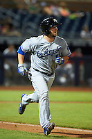 Glendale Desert Dogs catcher Kyle Farmer (7) runs to first during an Arizona Fall League game against the Peoria Javelinas on October 19, 2015 at Peoria Stadium in Peoria, Arizona.  Glendale defeated Peoria 4-2.  (Mike Janes/Four Seam Images)