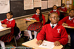 K-8 Parochial School Bronx New York Grade 4 children sitting in rows listening in class horizontal