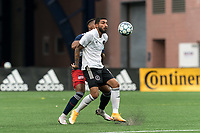 FOXBOROUGH, UNITED STATES - MAY 28: Shaan Hundal #10 of Fort Lauderdale CF attempts to control the ball as Francois Dulysse #60 of New England Revolution II defends during a game between Fort Lauderdale CF and New England Revolution II at Gillette Stadium on May 28, 2021 in Foxborough, Massachusetts.