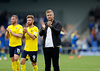 4th September 2021; Merton, London, England;  EFL Championship football, AFC Wimbledon versus Oxford City: A disappointed Oxford United manager Karl Robinson applauds the Oxford United fans after full time