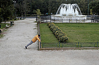 Pictured: A man exercises in the Zappeio Park.<br /> Re: Police patrol the streets to enforce the measures of self-isolation in an effort to fight the Coronavirus Covid-19 pandemic in Athens, Greece.