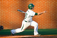Justin Roland (16) of the Charlotte 49ers follows through on his swing against the Delaware State Hornets at Robert and Mariam Hayes Stadium on February 15, 2013 in Charlotte, North Carolina.  The 49ers defeated the Hornets 13-7.  (Brian Westerholt/Four Seam Images)