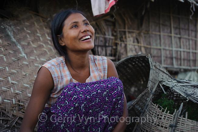 Rakhine girl who lives on an ephemeral barrier island inn the Bengal Sea. Rakhine State, Myanmar. January.