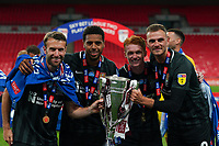 Northampton Town players celebrate promotion to League One with the trophy after a 4-0 victory in the Sky Bet League 2 PLAY-OFF Final match between Exeter City and Northampton Town at Wembley Stadium, London, England on 29 June 2020. Photo by Andy Rowland.