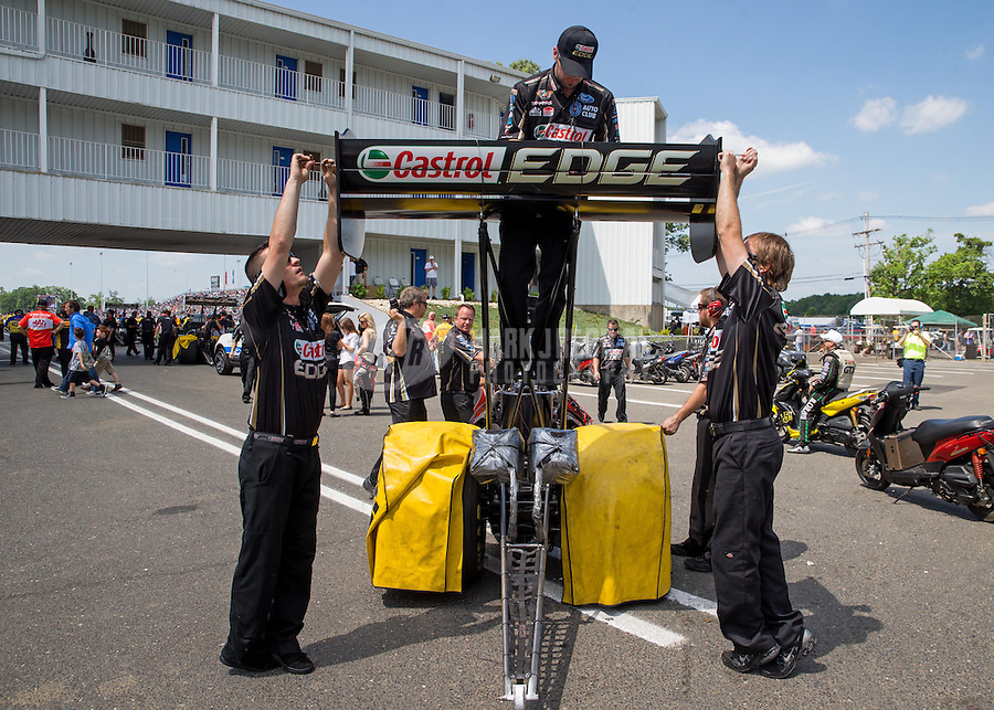 Jun. 2, 2013; Englishtown, NJ, USA: NHRA crew members adjust the rear wing on the top fuel dragster of driver Brittany Force during the Summer Nationals at Raceway Park. Mandatory Credit: Mark J. Rebilas-