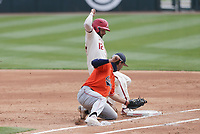 Arkansas catcher Casey Opitz (12) slides to first as Auburn Tyler Miller (10) tries to tag, Saturday, April 3, 2021 during the second inning of a baseball game at Baum-Walker Stadium in Fayetteville. Check out nwaonline.com/210404Daily/ for today's photo gallery. <br /> (NWA Democrat-Gazette/Charlie Kaijo)