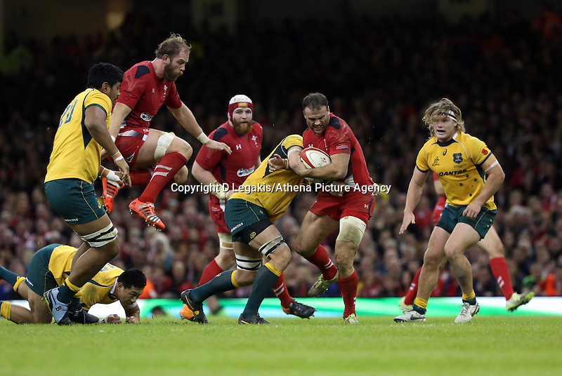 Pictured: Jamie Roberts of Wales (with ball) is brought down by an Australia player. Saturday 08 November 2014<br /> Re: Dove Men Series rugby, Wales v Australia at the Millennium Stadium, Cardiff, south Wales, UK.