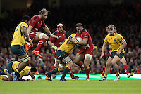 Pictured: Jamie Roberts of Wales (with ball) is brought down by an Australia player. Saturday 08 November 2014<br />