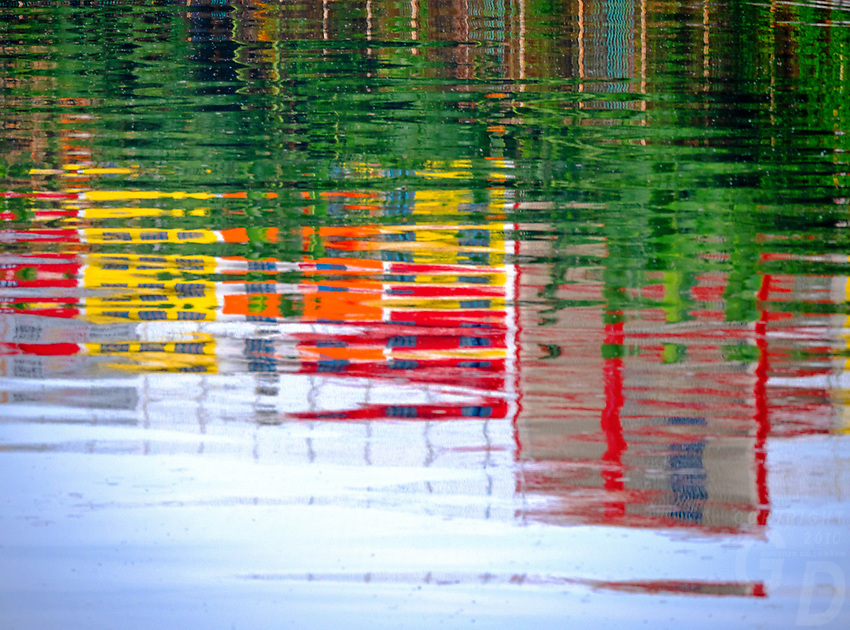 Colourful Buildings reflecting in a river North Harbour Manila, Philippines