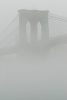 AVAILABLE FROM JEFF AS A FINE ART PRINT.<br /> <br /> AVAILABLE FROM PLAINPICTURE FOR COMMERCIAL AND EDITORIAL LICENSING.   Please go to www.plainpicture.com and search for image # p5690015.<br /> <br /> Brooklyn Bridge in the fog, New York City, New York State, USA