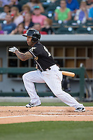 Leury Garcia (24) of the Charlotte Knights follows through on his swing against the Columbus Clippers at BB&T BallPark on May 27, 2015 in Charlotte, North Carolina.  The Clippers defeated the Knights 9-3.  (Brian Westerholt/Four Seam Images)