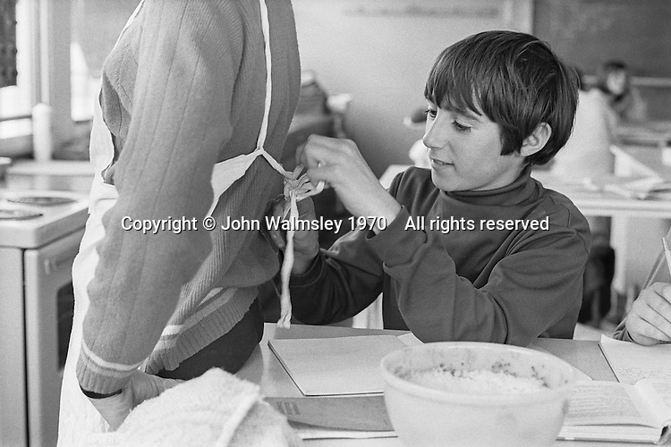 Boys sorting out their aprons for cooking class, Whitworth Comprehensive School, Whitworth, Lancashire.  1970.