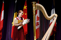 First prize winner Melanie Laurent from France receives the Lyon and Healy Concert Grand Harp during the awards ceremony of the 11th USA International Harp Competition at Indiana University in Bloomington, Indiana on Saturday, July 13, 2019. (Photo by James Brosher)
