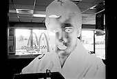 Tupelo, Mississippi<br /> USA<br /> August 11, 2002<br /> <br /> Elvis Presley's face frosts a window at a McDonalds dedicated to the King in the town of his birth.