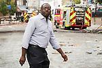 © Joel Goodman - 07973 332324 . 07/08/2011 . London , UK . DAVID LAMMY MP arrives to inspect the scene at Tottenham High Street . Overnight rioting and looting in Tottenham , following a protest against the police shooting of Mark Duggan . Photo credit : Joel Goodman