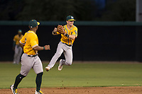 AZL Athletics second baseman Nick Ward (4) attempts a throw to first base during an Arizona League game against the AZL Athletics at Camelback Ranch on July 15, 2018 in Glendale, Arizona. The AZL White Sox defeated the AZL Athletics 2-1. (Zachary Lucy/Four Seam Images)