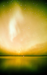 Northern lights above Clear Lake Manitoba Canada, human activity.